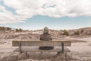 image of an elder on the beach